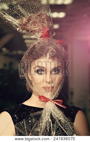 High Fashion Portrait Of Elegant Woman. Girl With Transparent Wrapper On Face, Present. Woman Face M