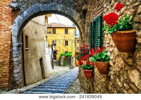 Beautiful charming old streets with floral decoration in italian villages