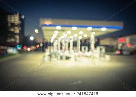 Vintage Blurred Gas Station In Houston, Texas, Usa At Blue Hour