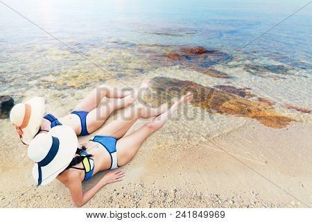 Young Asian Women In Bikini On Beach At Summer,relaxing,holiday Concept.