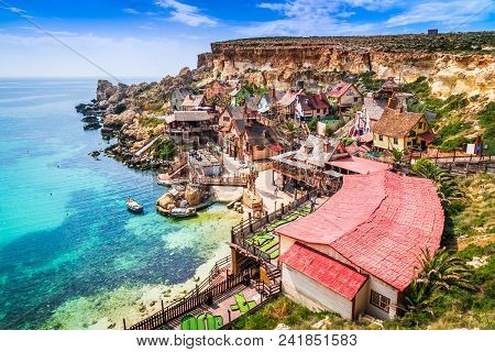 Malta, Il-mellieha. View Of The Famous Village Popeye And Bay On A Sunny Day. Malta.
