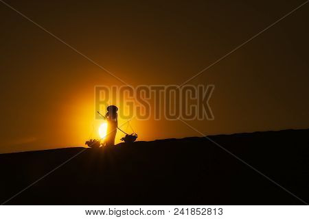 Vietnam Woman Wearing Ao Dai Culture Traditional At White Sand Dune Desert During Sunrise At Summer