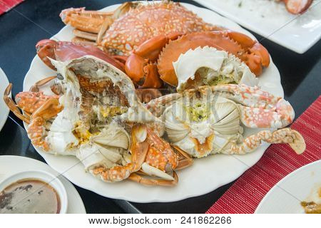 Steamed Serrated Mud Crabs And Horse Crabs On White Dish In Buffet Meal