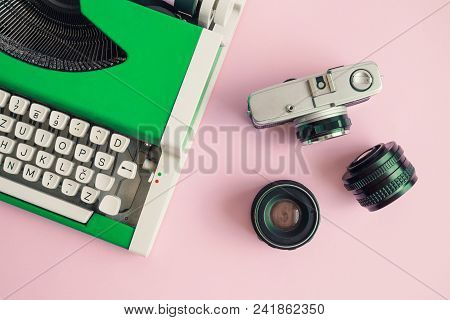 Flat Lay Of Green Typewriter And Retro Camera With Lenses On Pastel Pink Background Minimal Creative