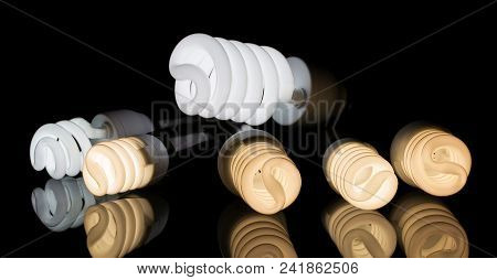 Energy-saving Fluorescent Bulb In Operation, With Different Color Rendering Index, Isolated On Black