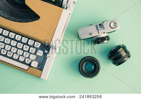 Flat Lay Of Yellow Typewriter And Retro Camera With Lenses On Table Minimal Creative Concept.