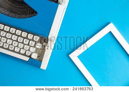 Retro Vintage Typewriter And Photo Frame Blue Minimal Creative Concept.