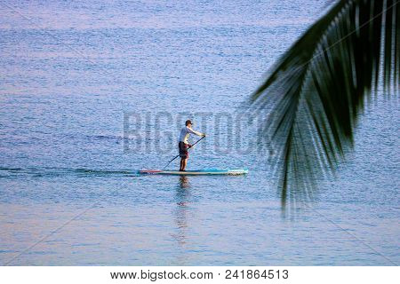 May 16, 2018 In Hilo, Hi:  Person Paddle Boarding In The Hilo Bay, Hi Where People Can Enjoy Water R
