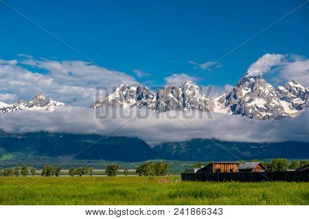 Grand Teton Mountains with low clouds. Grand Teton National Park, Wyoming, USA.