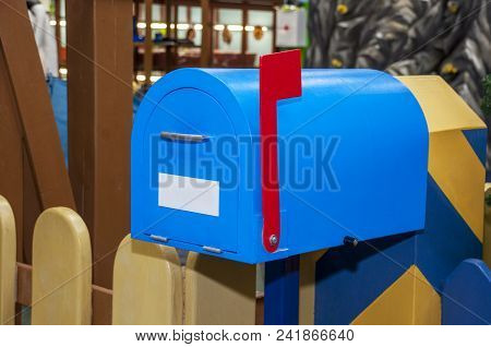 Vintage Blue Mail Box With Red Raised Flag And White Blank Label For Inscription