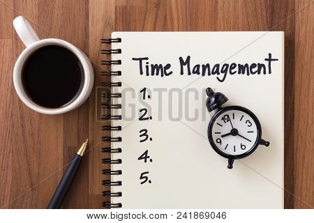 Time Management Concept With Computer, Clock And List On Notebook