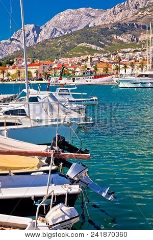 Colorful Makarska Boats And Waterfront Under Biokovo Mountain View, Dalmatia Region Of Croatia