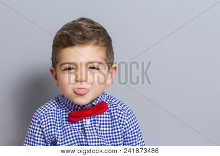 Cute Boy With Bow Tie Making A Grin