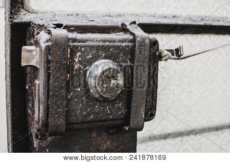 Old Metal Lock Latch And A Glass Door Bar