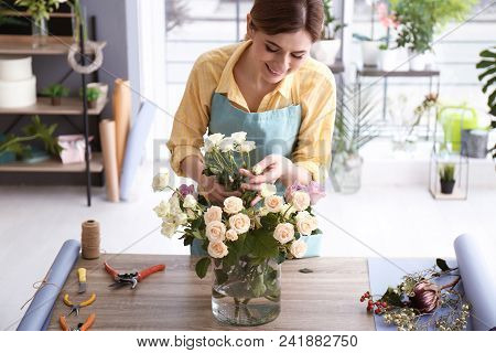 Female Florist Creating Floral Composition At Workplace