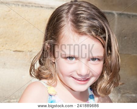 Portrait Of Smiling Shy Kid Young Girl