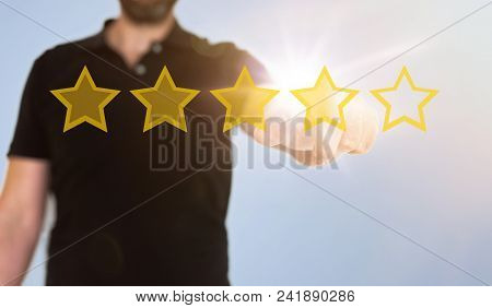 Businessman Touching Translucent Touch Screen Interface With Golden Rating Stars, Digital Composite