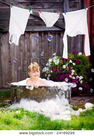Little girl in a retro bath