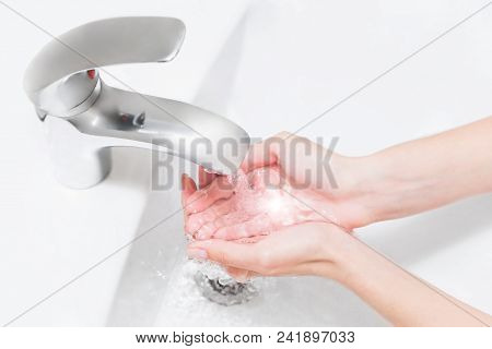 Hands Wash With Water In White Sink. Retouched Conseptual Photo Of Purity