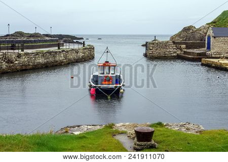 A Little Boat Found At The Picturesque Ballintoy Harbour.