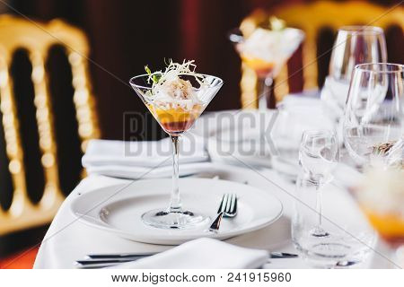 Wedding Table Decorated With White Plates, Glasses For Wine And Cocktail In Spacious Hall. Elegant D