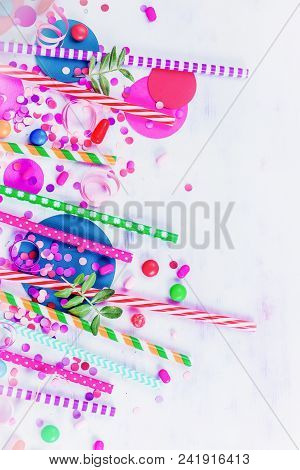 Cocktail Straws, Confetti And Candies Close-up In A Colorful Party Supplies Concept On A Light Backg