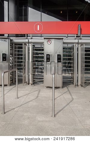 Entrance To Office Through Big In Full Human Growth Stainless Steel Turnstiles. Concept Of Security,