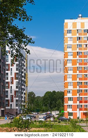 Modern Residential Complex On The Background Of The Blue Sky. These Are Houses Of Variable Height In