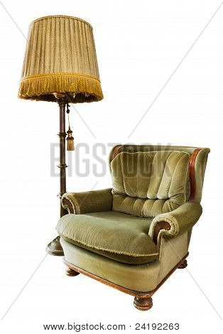 Old Luxury Armchair With Floor Lamp On White