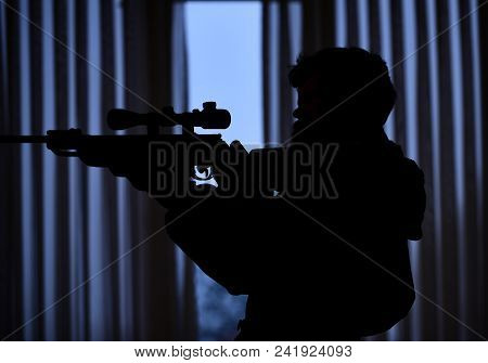 Silhouette Of Macho Aiming At Victim In Front Of Window. Hunter, Soldier With Gun Aiming Before Shoo