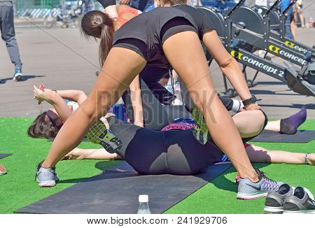 Saint-petersburg.russia. May.20.2018.young Girls Perform Warm-up Massage For Athletes.muscles Relax.