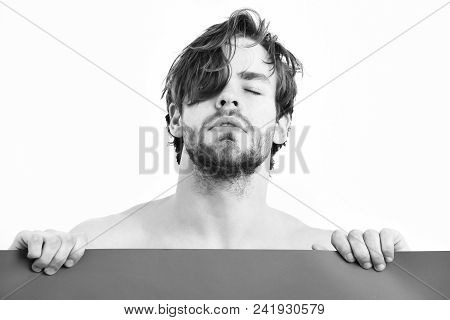 Bearded man, short beard. Caucasian sexy topless athletic young amused macho with stylish beard and moustache holding red plank isolated on white background poster