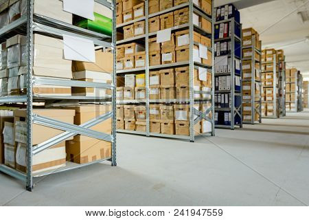 Stacks Of Files And Paperwork Placed In Bookshelves With Folders And Documents In Cardboard Box Arch