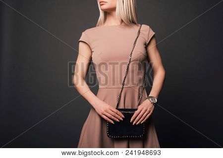 Close-up Of Unrecognizable Woman With Beautiful Trendy Manicure Wearing Holding Small Black Fancy Ha