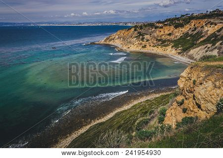Stunning Coastal View Of Steep Palos Verdes Cliffs On A Sunny Day With South Bay Beach Cities In The