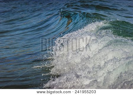 Close-up Of Calm Waves Washing Onto The Shores Of Secluded Dume Cove Beach, Malibu, California