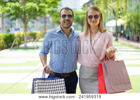 Stylish Family Couple Having Weekend Break And Doing Shopping. Handsome Man And Beautiful Woman In S