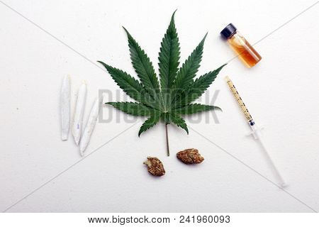 Marijuana Leaf, Rolled Joints, Buds, Honey Oil, CBD Oil. Recreational and Medical Marijuana examples isolated on white with room for text.