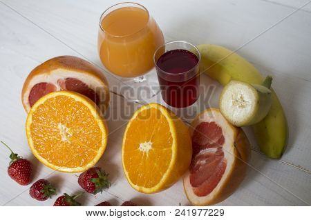 Citrus Fruits And Cooking Citrus Juice Background. Assorted Fresh Citrus Fruits With Leaves. Orange,