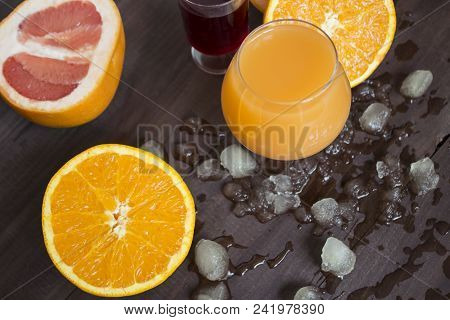 Ice Background. Abstract Ice Texture. Winter Background. Ice On A Wooden Background With Oranges, Ci
