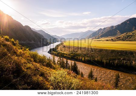 Incredible Landscape Of Altai Mountain Valley With River At Sunset. Altai Mountains Landscape.