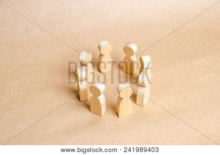 People Stand In A Circle. A Circle Of People. The Concept Of Discussion And Cooperation, Coordinatio