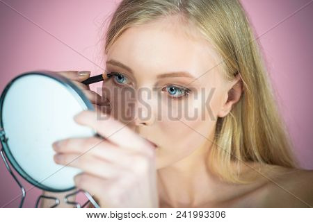 Eyeliner Makeup. Attractive Blonde Woman Putting Makeup. Sexy Girl Applying Pencil For Eyes Looks In