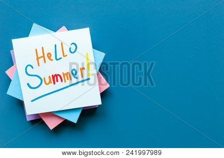 Hello Summer - Inscription Of Many Colored Letters At Notes On Blue Background. First Summer Day, Ca