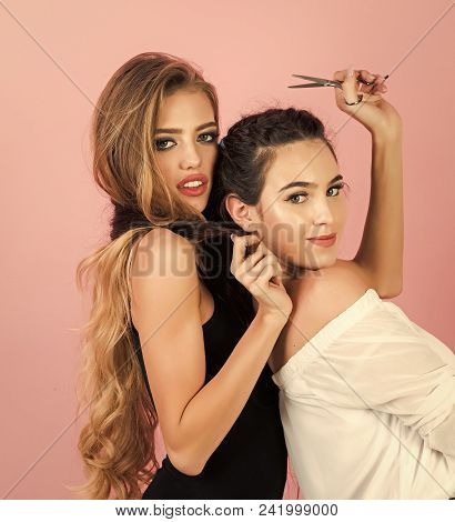 Female Face. Issues Affecting Girls. Two Young Girl Friends Having Fun And Smiling. Brunette Making
