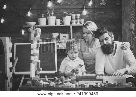 Kids Playing With Toys. Family Leisure Concept. Parents Hugs, Watching Son Playing, Enjoy Parenthood