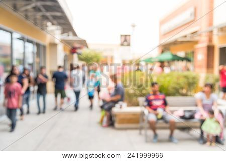 Blurred People Rest At Outlet Shopping Mall In Usa