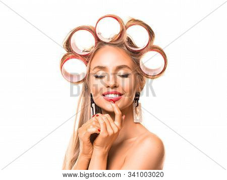 Close Up Portrait Of A Beautiful Woman With Hair Rollers On White Background. Happy Woman With Close