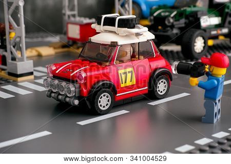 Tambov, Russian Federation - August 18, 2019 Lego Man With Camera Taking A Picture Of 1967 Mini Coop