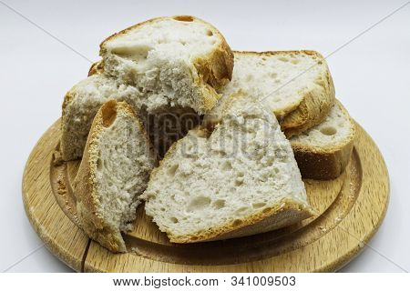 Slices Of An Apulian Bread, Italian Pane Pugliese, Isolated On White Background